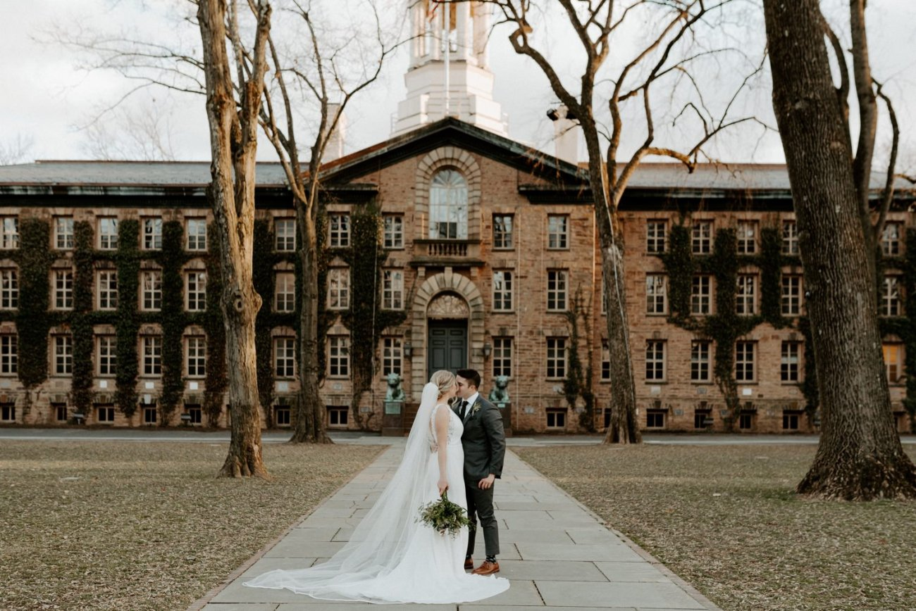 Bride And Groom Standing In Front Of Princeton University Nj