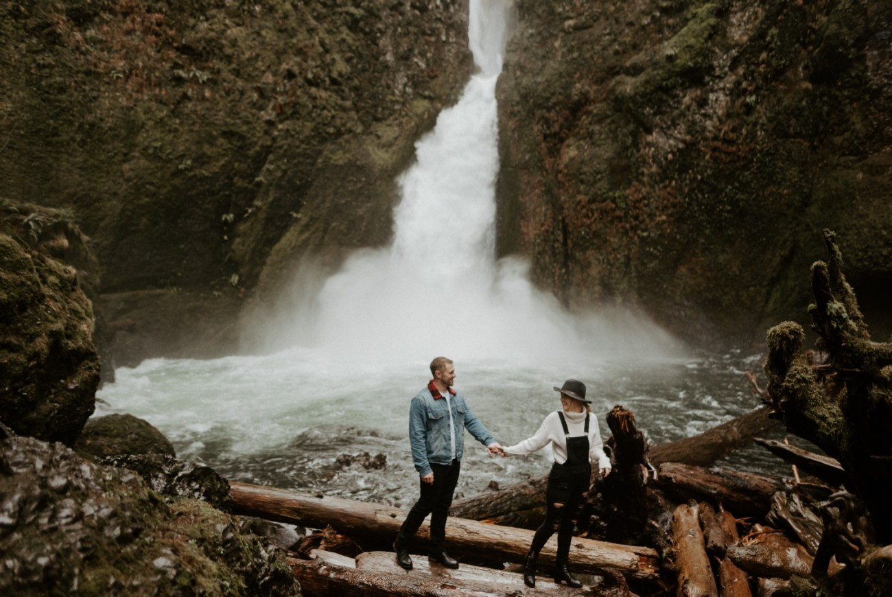 Couple standing in front of Wahclella Falls near Portland Oregon
