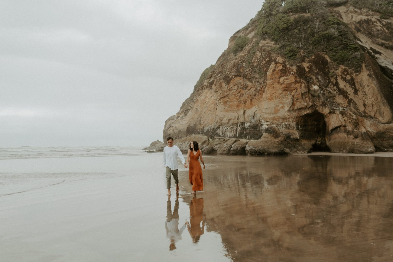 Couple Walking On Hug Point Beach Cannon Beach Elopement Best Elopement Locations In Oregon Portland Wedding Photographer 001