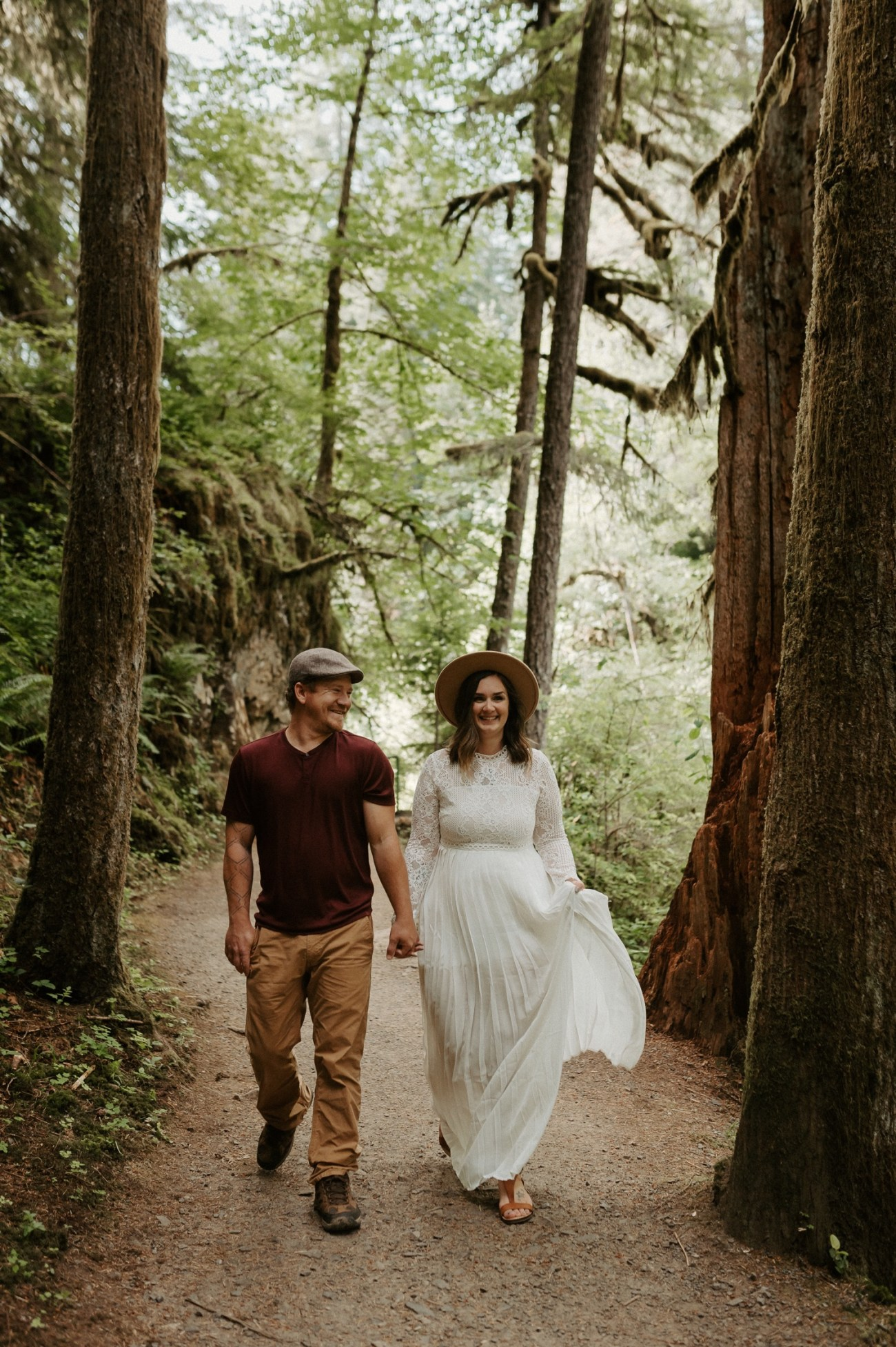 Couple walking on trails at Silver Falls State Park for their engagement photos. Anais Possamai Photography