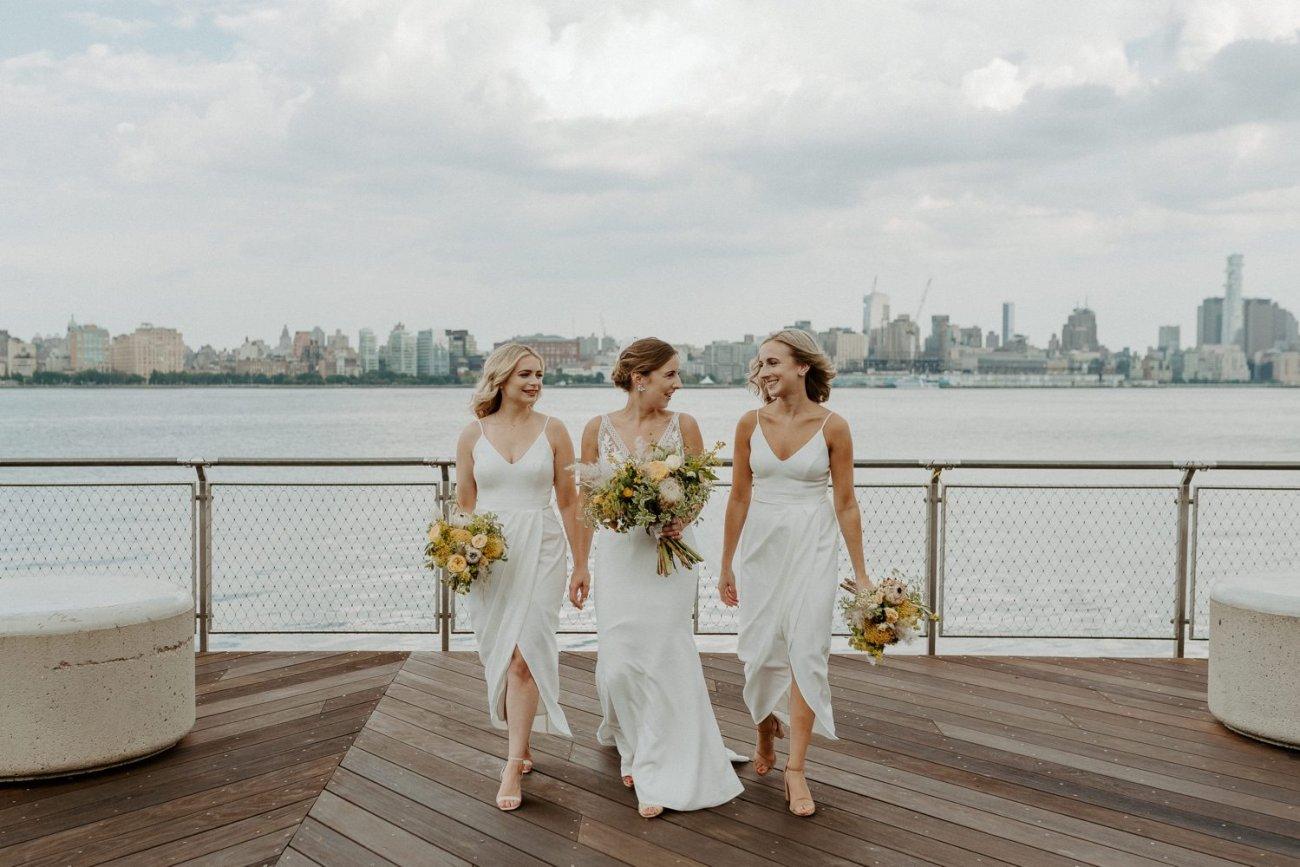 Bridal party walking at the Pier A in Hoboken New Jersey. Antique Loft Hoboken Wedding New Jersey Wedding Photographer Anais Possamai Photography 037
