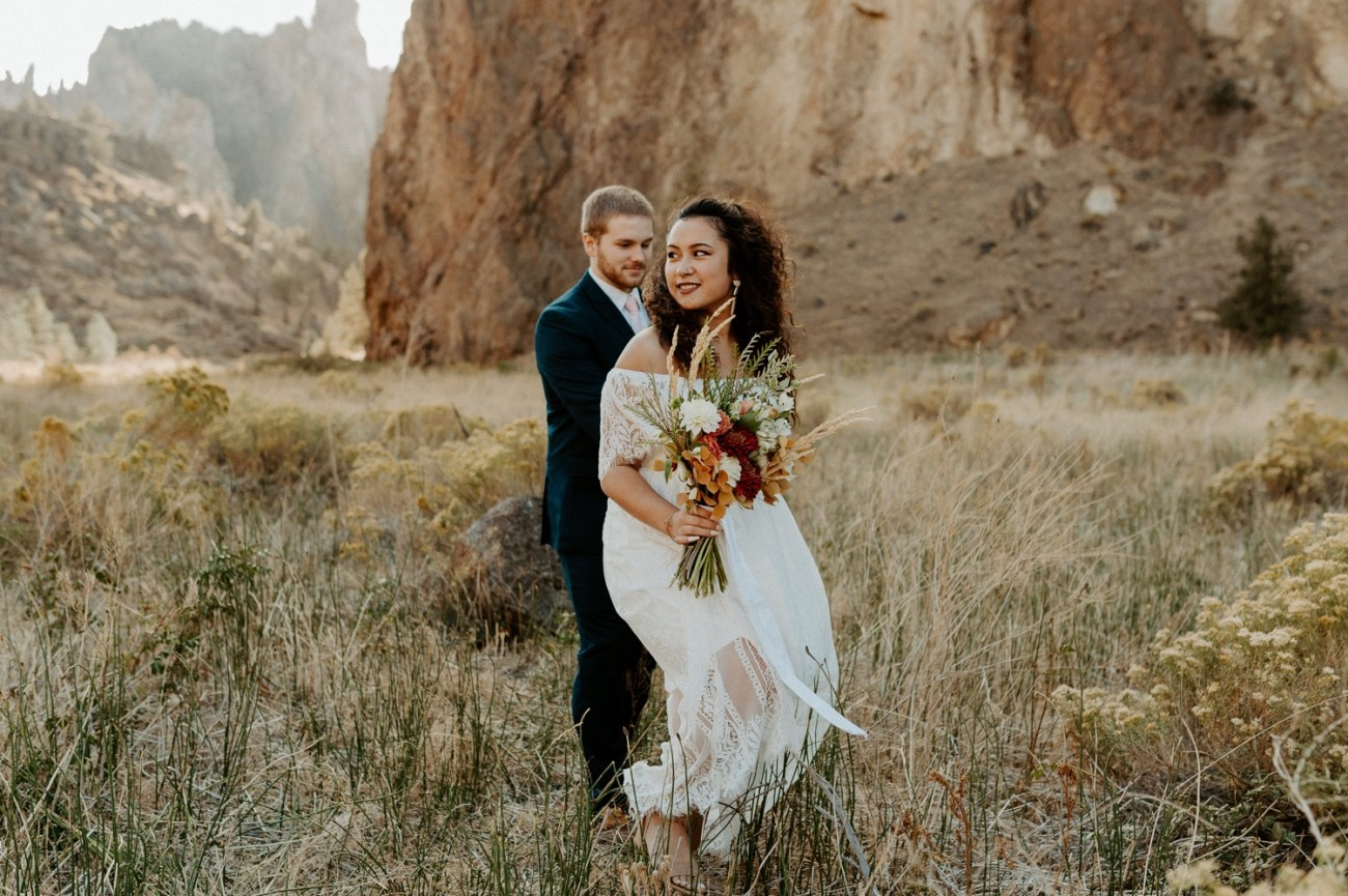 Couple walking around Smith Rock State Park for their elopement. Anais Possamai Photography