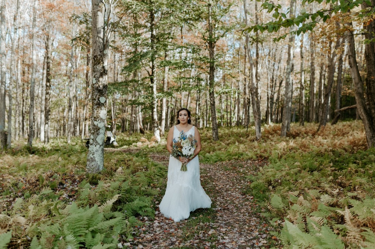 Bride walking down the aisle in Handsome Hollo Wedding venue in the Catskills. Anais Possamai Photography