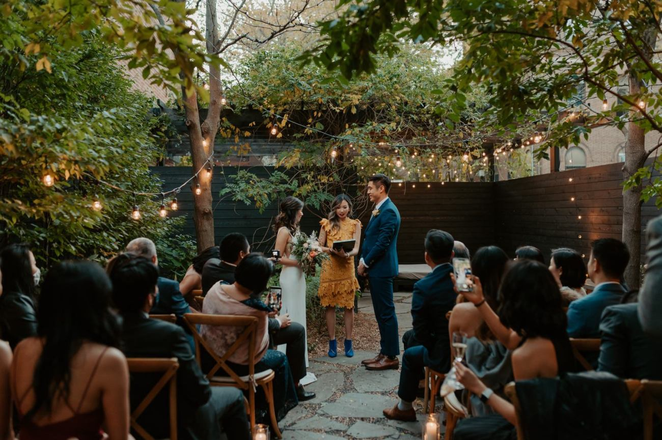 Bride and Groom standing at their ceremony for their Brownstone Backyard Wedding in Brooklyn. Anais Possamai Photography