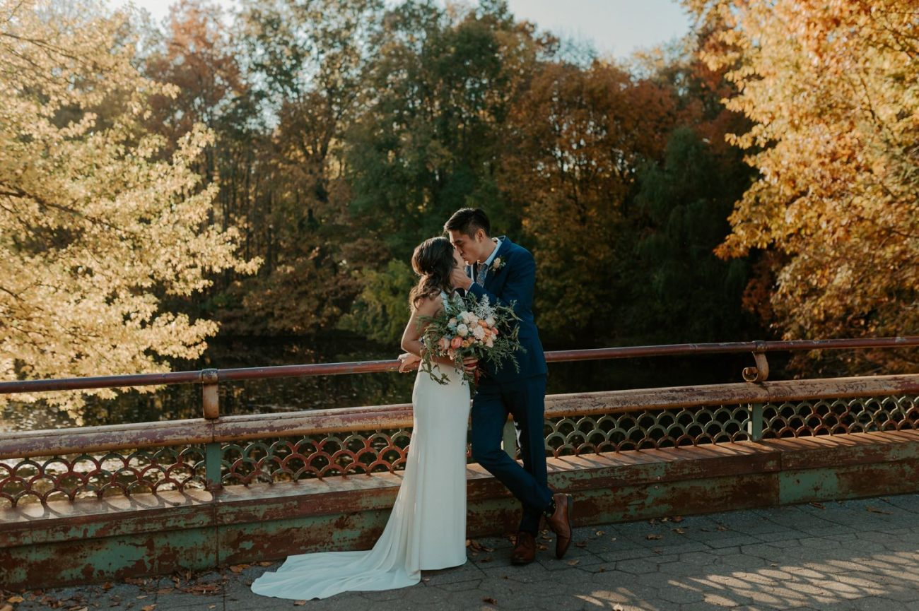 Bride and Groom kissing on the bridge in Prospect Park Brooklyn for their bridal portrait. Anais Possamai Photography
