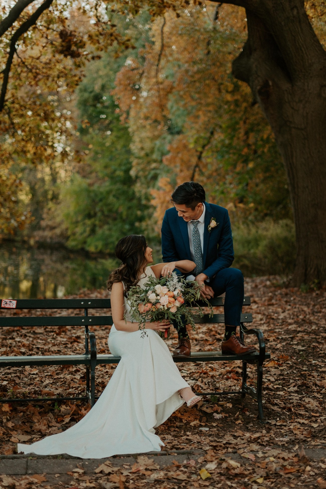 Bride and Groom sitting on a bench in Prospect Park for their bridal portrait. Anais Possamai Photography