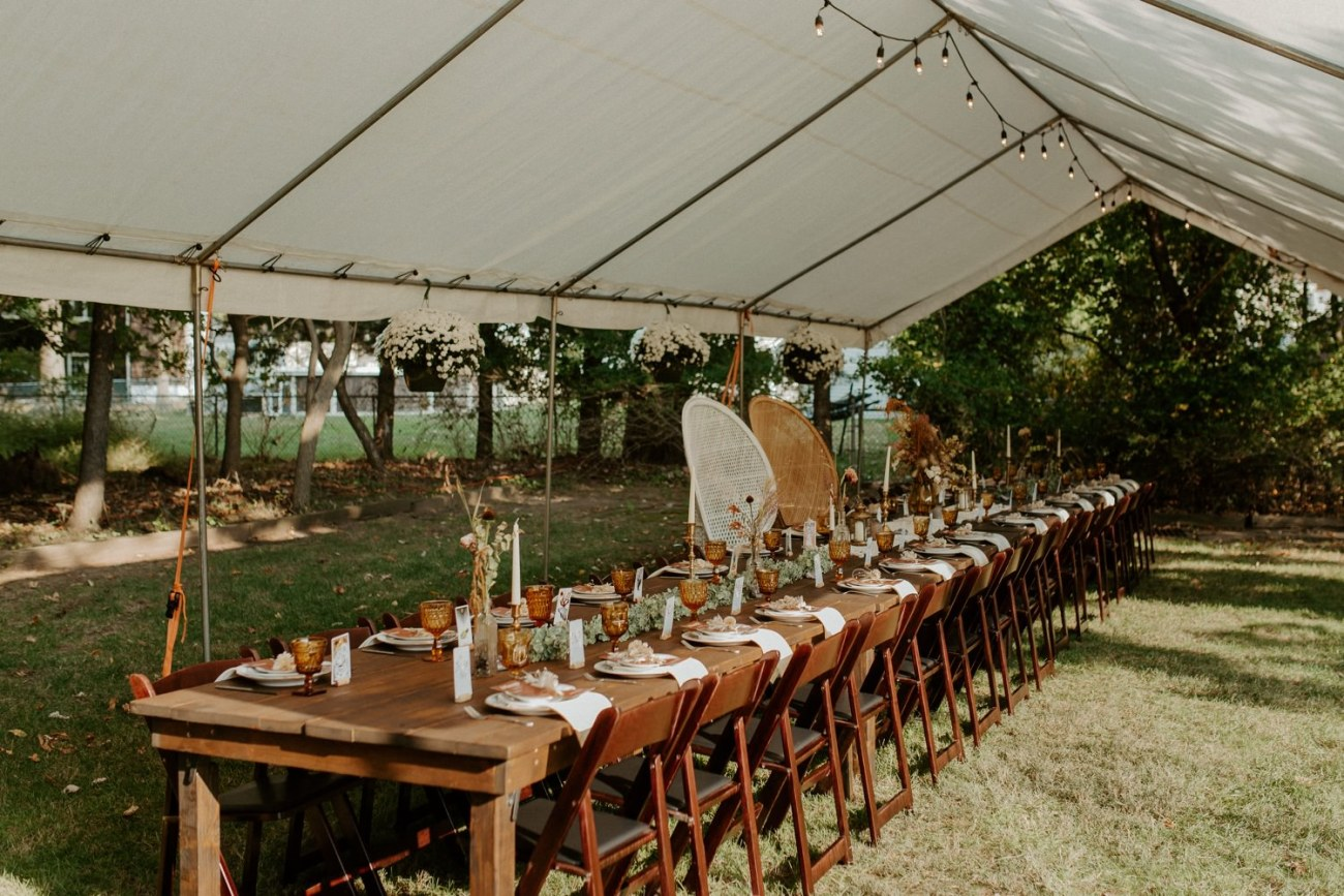 Boho and Vintage Table décor for backyard wedding reception with thrifted details