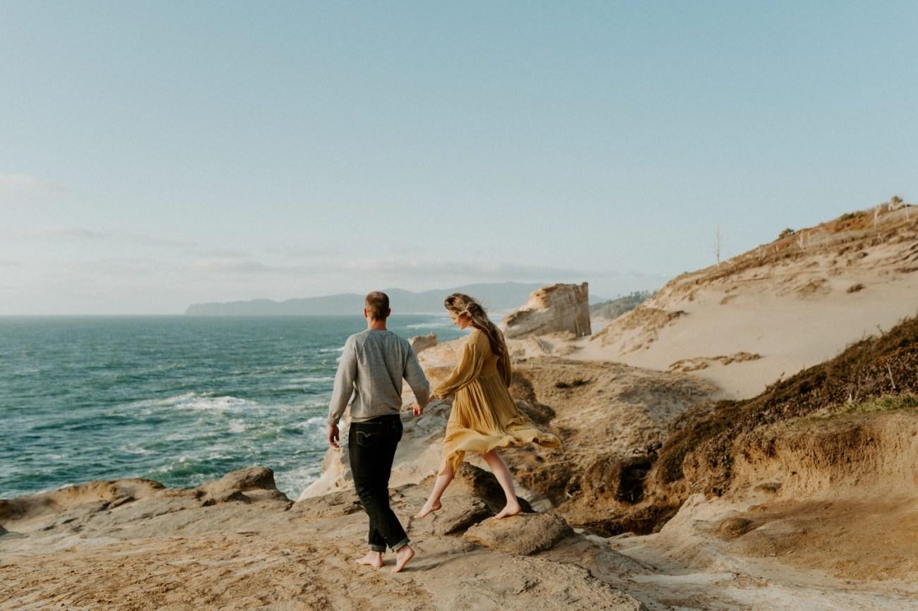 Couple walking on the dunes in Pacific City Cape Kiwanda Oregon