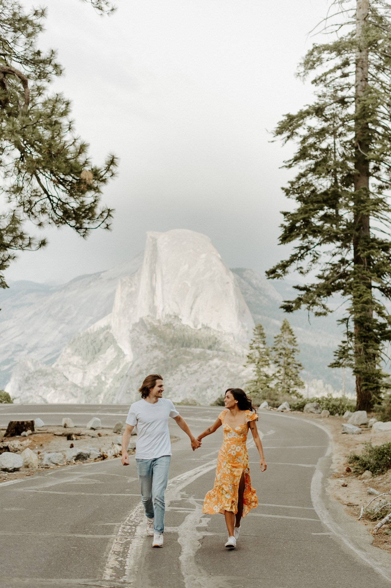 Couple running on Glacier Point road for their couple session