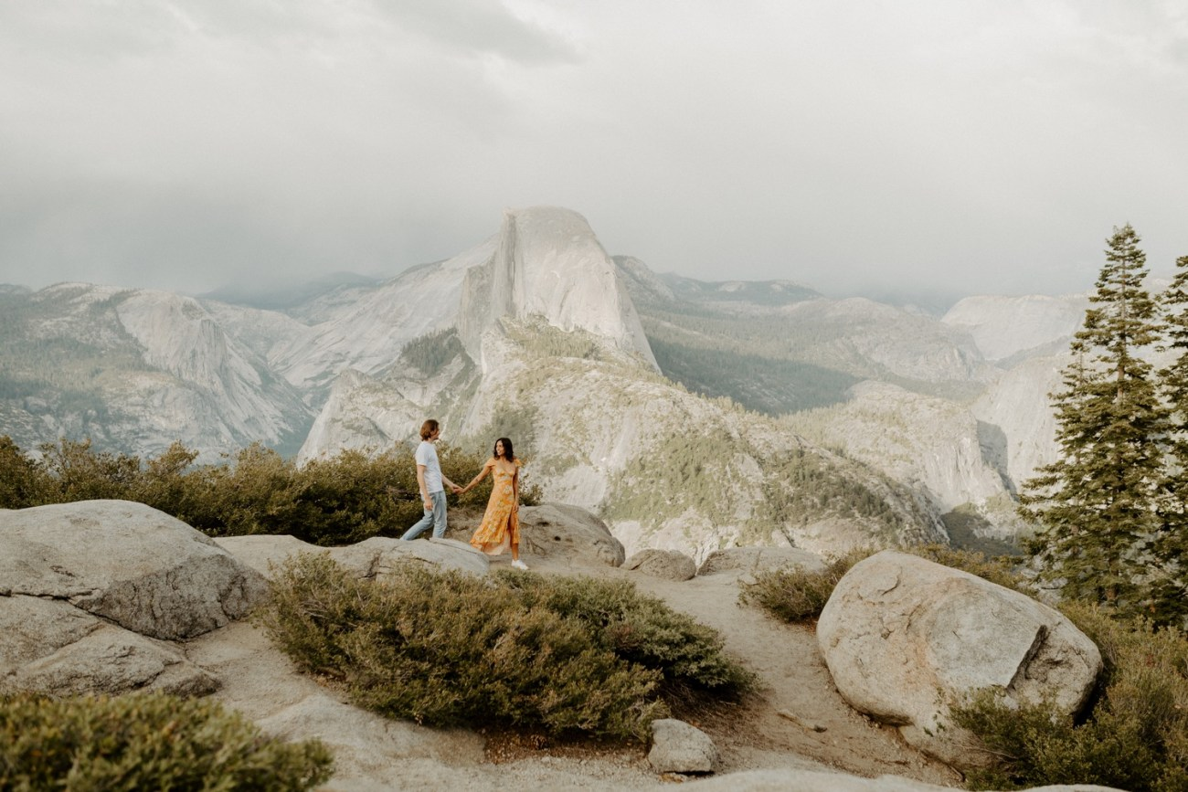 Couple walking at Glacier Point viewpoint in Yosemite National Park
