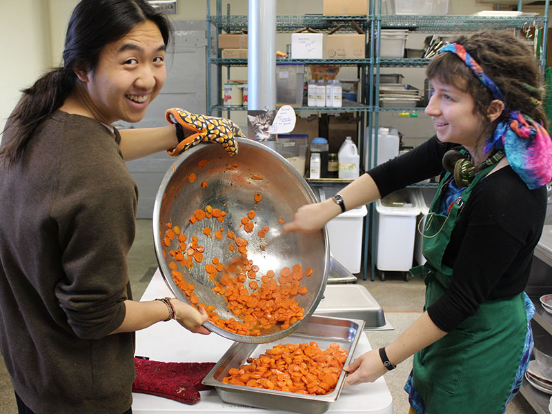 gap year students preparing a meal