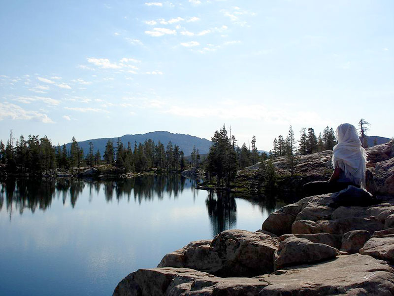 gap year student meditating by lake