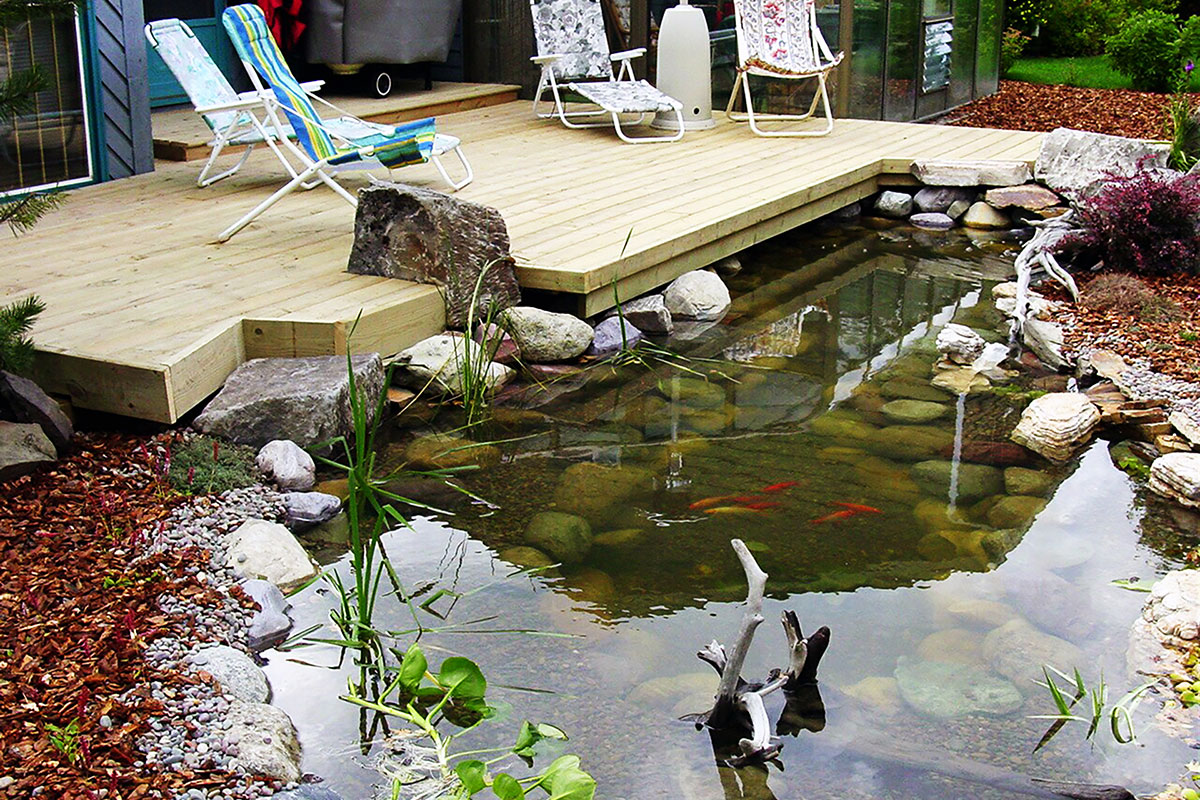 Water features that sooth your senses ananda landscapes for Koi pond deck