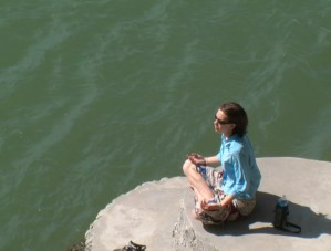 girl meditating by river