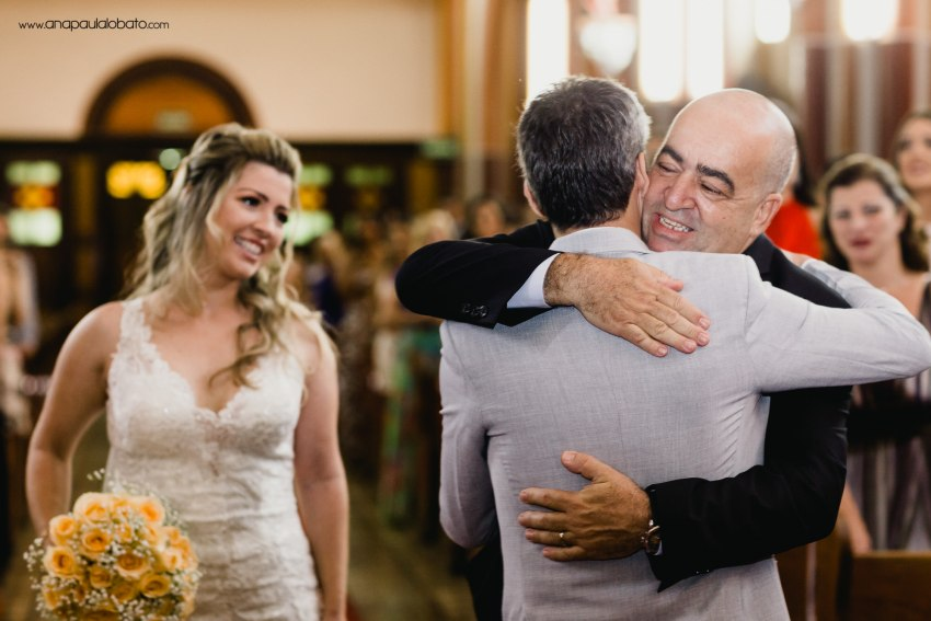 father hugs son in law