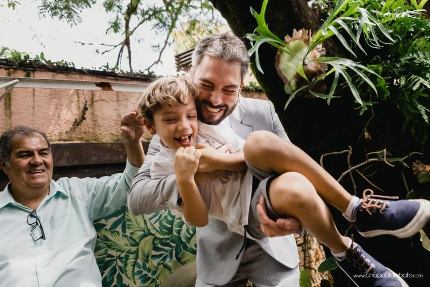 groom having fun with kids