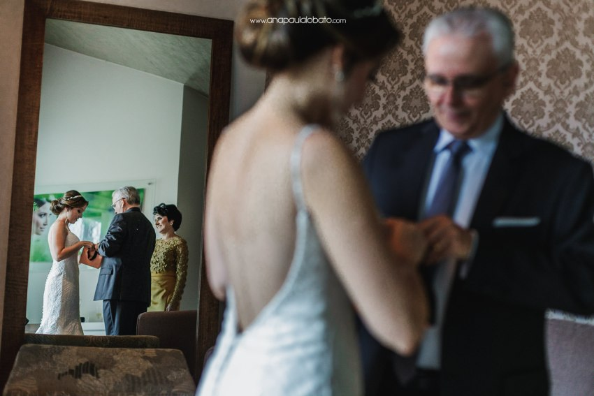 parents give a gift to the bride