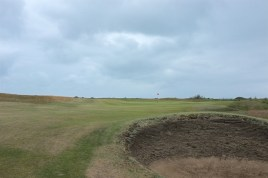 The view from the right-hand side of the 7th fairway showing the green and the hole's lone bunker.