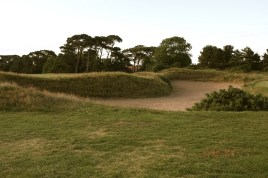 The view of the enormous cross bunker from the left-hand side. This bunker stretches the full width of the fairway and so must be carried with the tee shot.