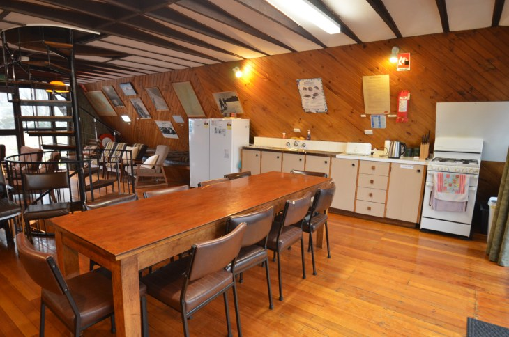 ANARE Ski Lodge Kitchen with fridge and freezer, cuboards, sink and stove on west side.