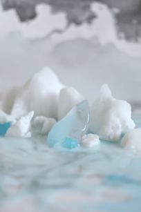 iceberg installation on marble and watercolor skies