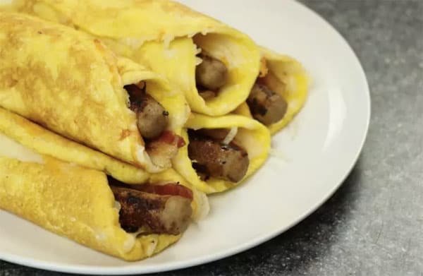 Low-Carb Breakfast Egg Wrap - 8 Easy Keto Breakfast to start burning fat. Keto Breakfast on the go, Keto breakfast make ahead recipes. Eggs cooked in creative ways are the basis of your breakfast on a Ketogenic diet. But it's not eggs only! You can have a no eggs Keto breakfast with muffins, Keto breakfast pancakes or Keto breakfast smoothie. #keto #ketogenic #ketodiet #breakfast #ketorecipes