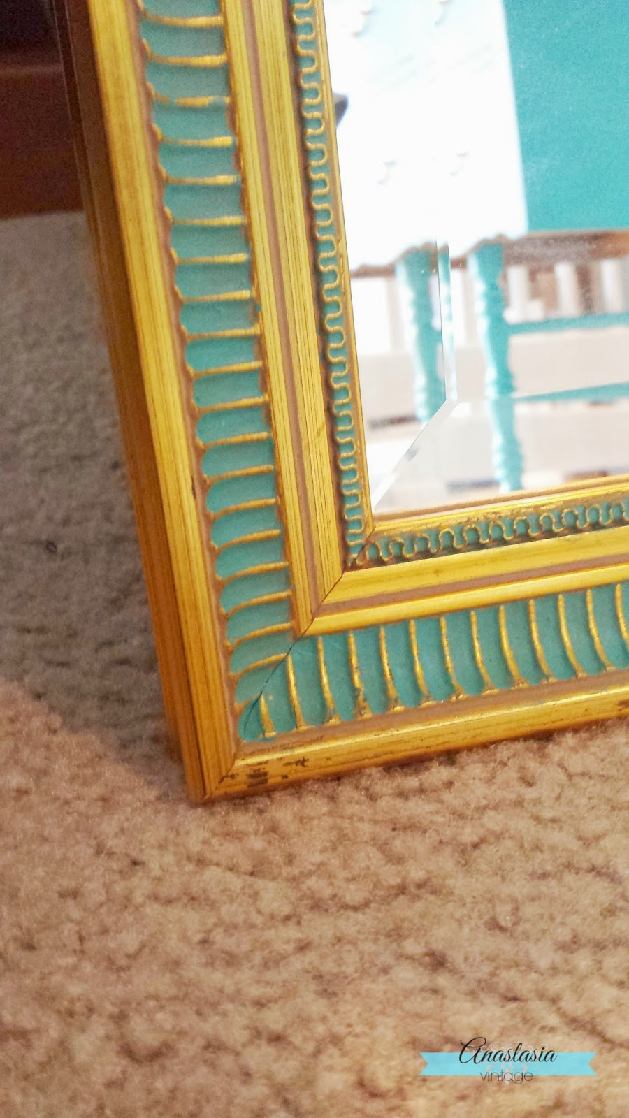 teal & gold mirror close up