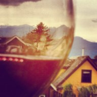 red wine with yellow house