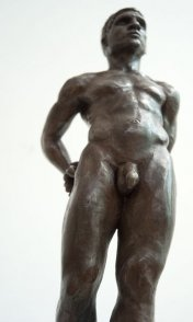 caudal frontal view of bronze sculpture of male nude standing figure