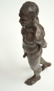 cranial lateral frontal view of bronze sculpture of male nude standing figure