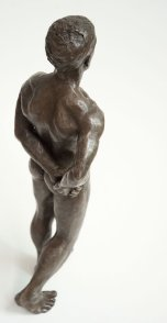 cranial dorsal lateral view of bronze sculpture of male nude standing figure