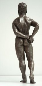 dorsal view of bronze sculpture of male nude standing figure