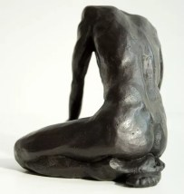 bronze sculpture of a male nude sitting on his knees