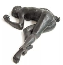 bronze sculpture of a female nude lying down
