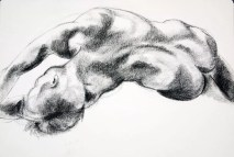 Figure drawing of a male nude lying on his side seen from the back