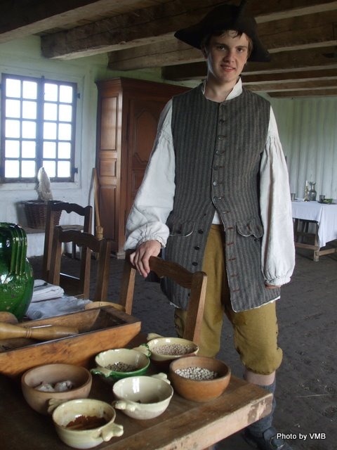 Tavern keeper's son explaining the ingredients. I took the Photo at Ft. Louisburg in Nova Scotia.