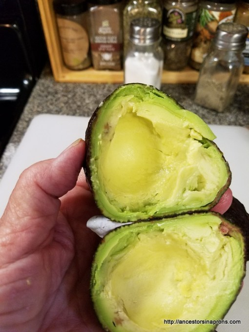 Open the cut avocado