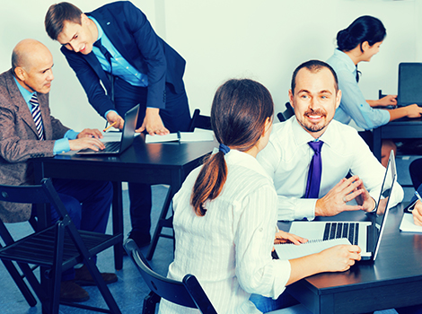 people talking in a businessplace, representing employee productivity caused by advanced IT solutions