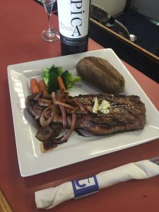 12oz New York Steak with Caramelized onions and sautéed mushrooms and balsamic reduction.