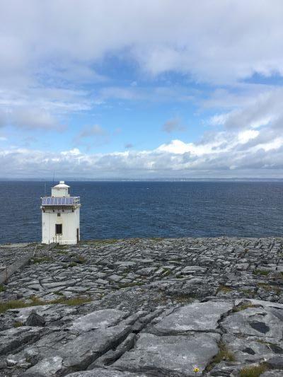 A photo of a lighthouse along the ocean