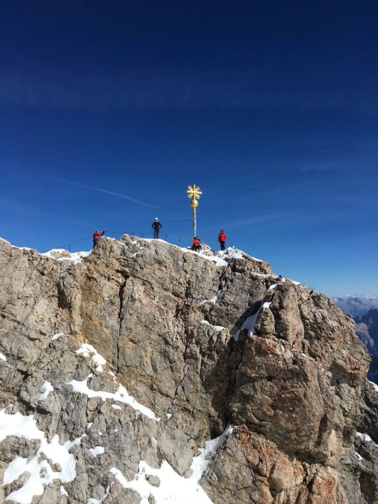 Hikers at the Zugspitze summit in Germany