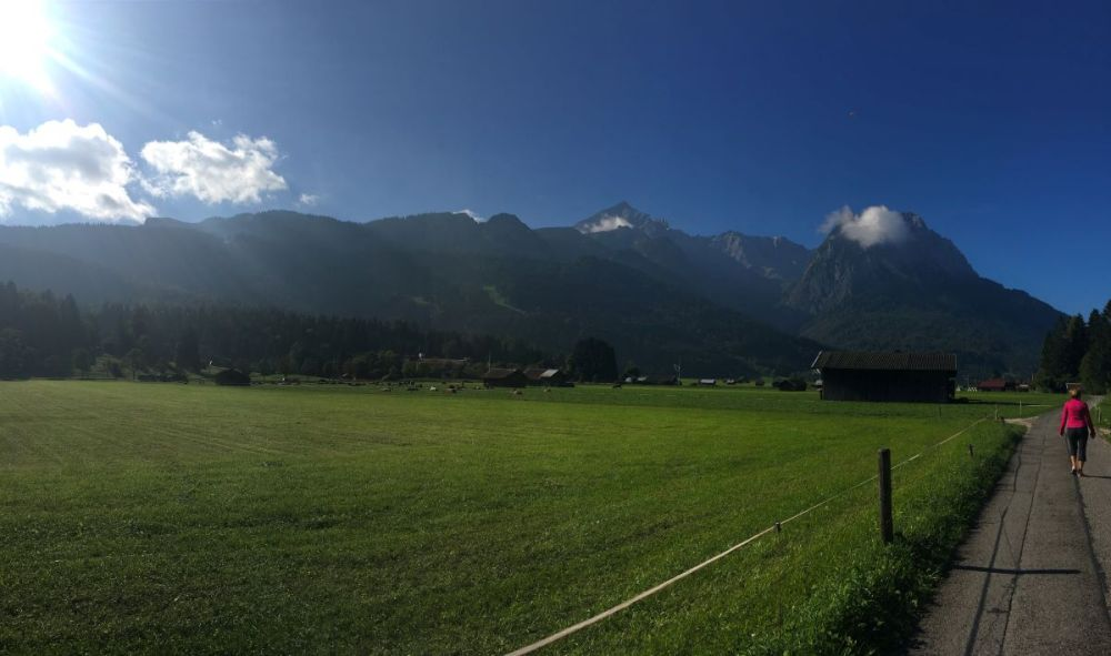 A woman walking on a hiking path in Garmisch