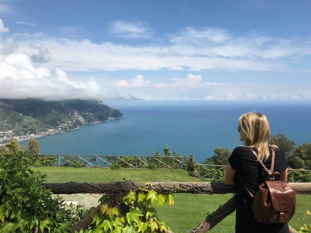 A woman looking at the Amalfi Coast from Villa Rufolo, one of the gardens in Ravello.