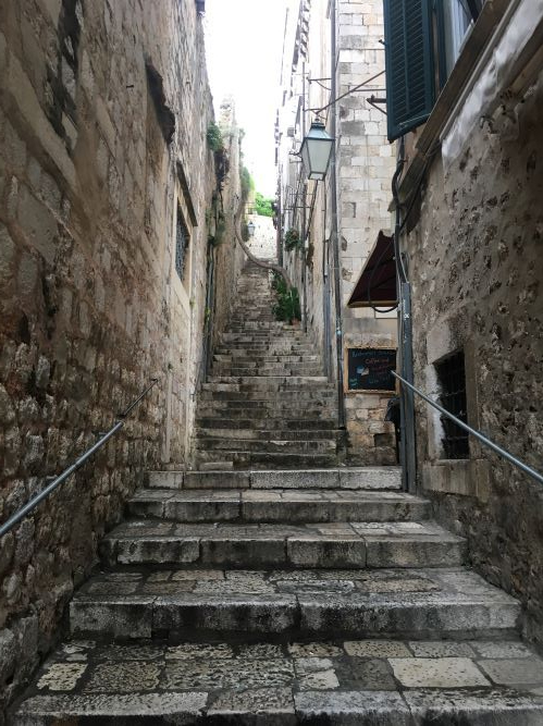 A photo of staircase in Dubrovnik made of cobblestone.
