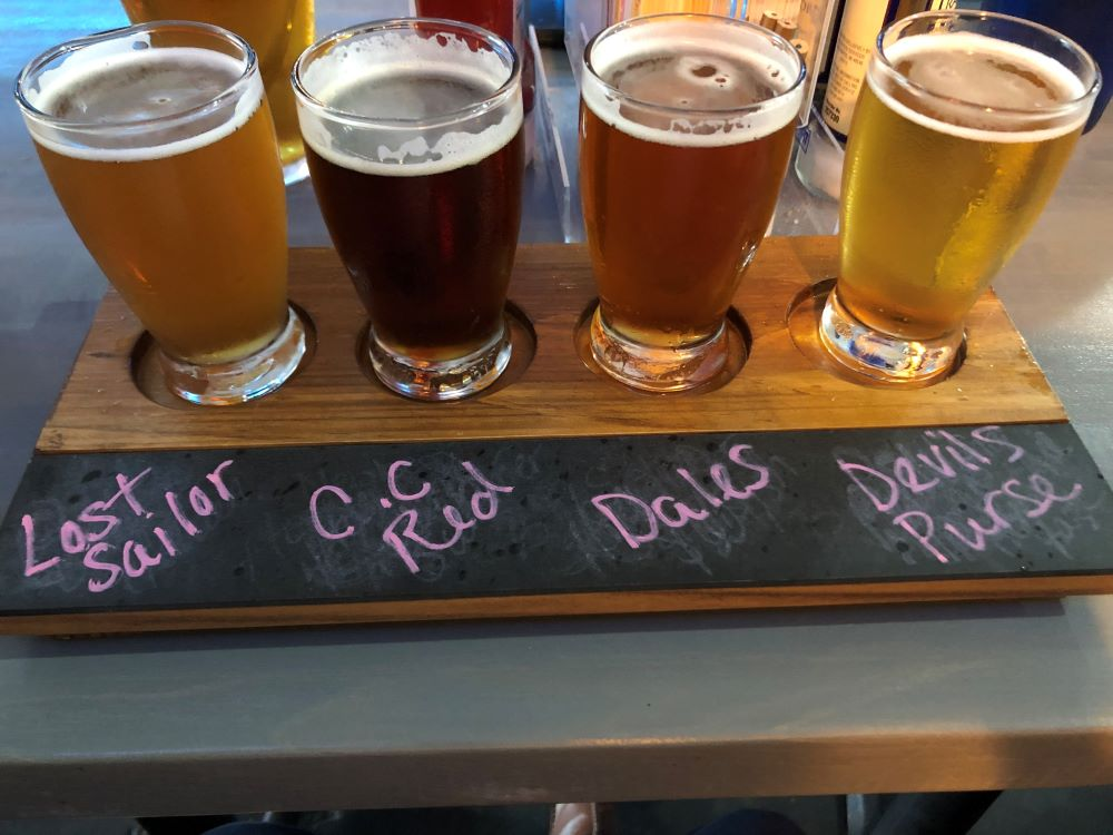 Four glasses of beer at a dive bar in Falmouth.