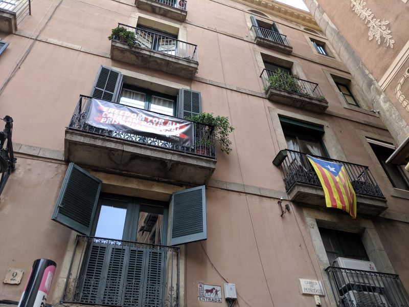 The exterior of a building with the catalan independence flag in Barcelona.