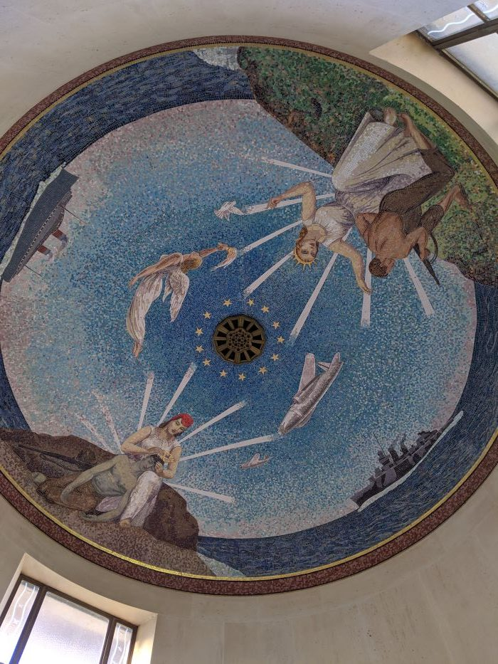 The interior dome of the chapel at the American Cemetery in Normandy is painted with two angels and two American soldiers.
