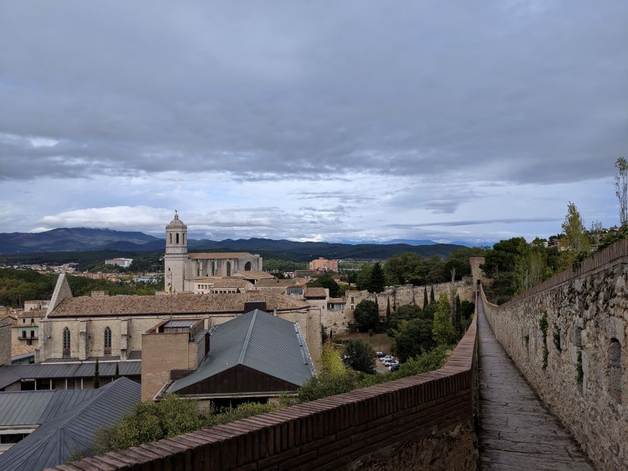 A view of the mountains and city from the city walls in Girona, which can be a day trip from Barcelona.