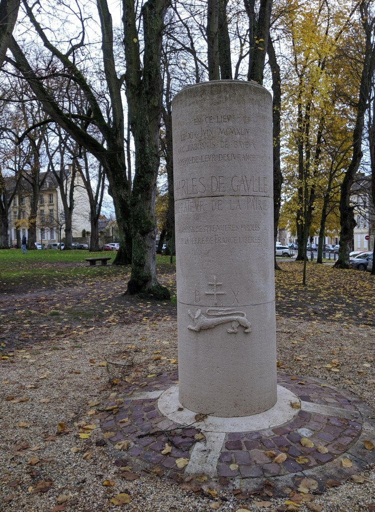 A stone cylinder memorial at the historic site where General Charles de Gaulle spoke to the citizens in 1944.