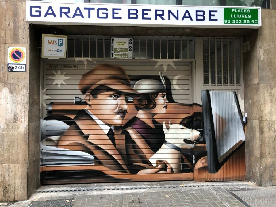 Street art on a garage door in the El Raval neighborhood of Barcelona